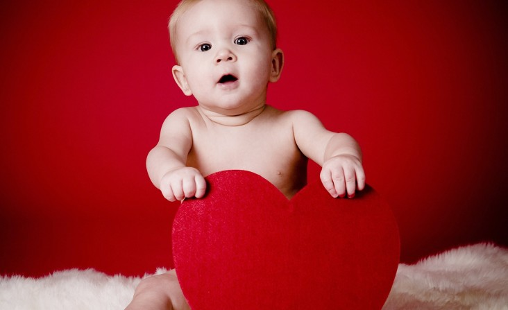 Holidays___Saint_Valentines_Day_Kid_with_a_heart_on_Valentine_s_Day_February_14_061439_